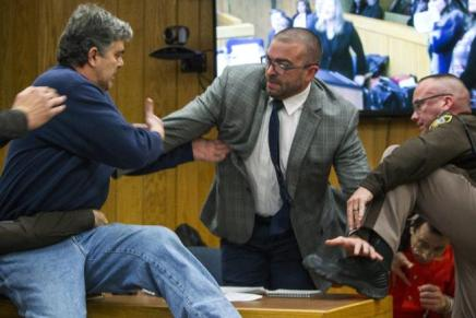 Victims Father lounges at Larry Nassar incourt