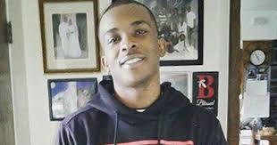 Unarmed black man fatally shot in his ownbackyard