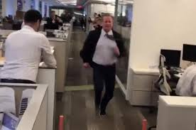 NFL Commissioner Roger Goodell Running the 40 yard dash in anoffice