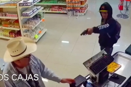 Robber in Mexico is quickly disarmed by acustomer.